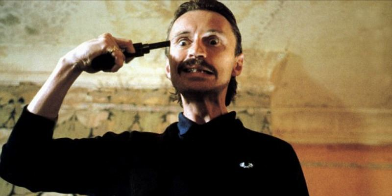 Begbie holds a gun to his head in Trainspotting.