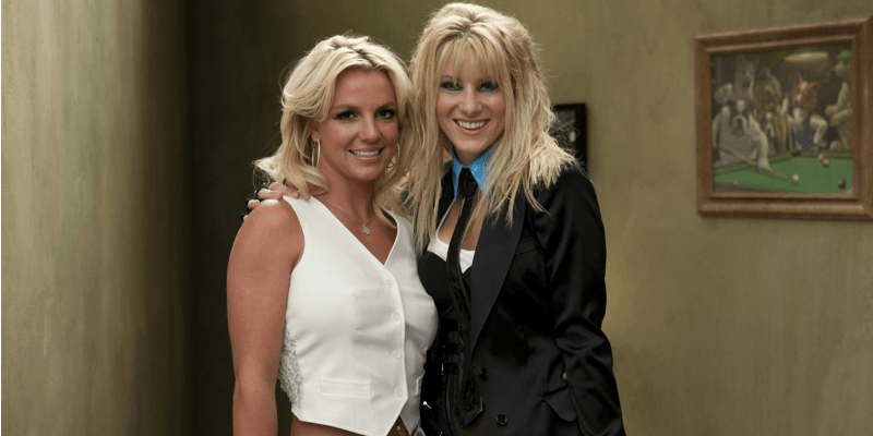 Heather Morris dressed as Britney Spears poses for a picture with Britney Spears on Glee.