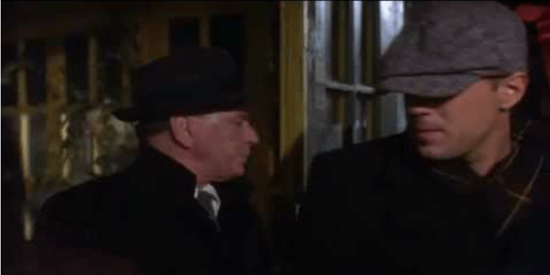 Bruce Willis in The First Deadly Sin in a coat and hat.