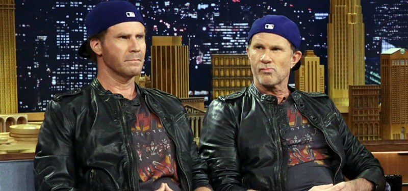 Will Ferrell and Chad Smith are dressed in the same hats, shirts, and leather jacket together