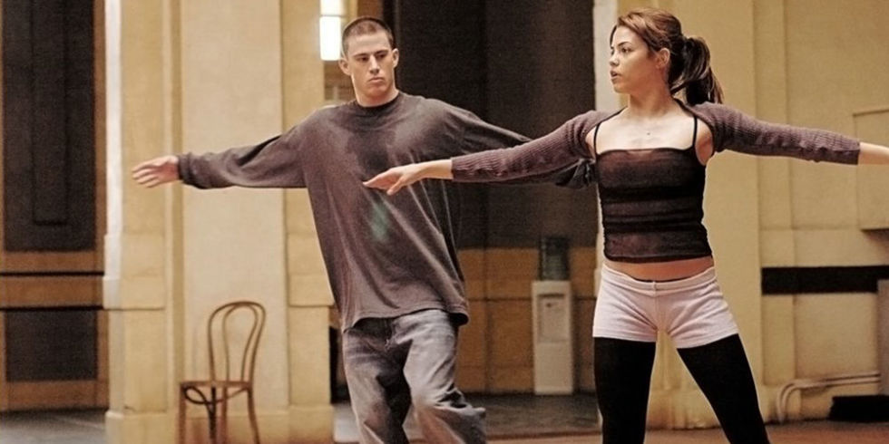 Channing Tatum with his arms out, dancing next to Jenna Dewan in Step Up