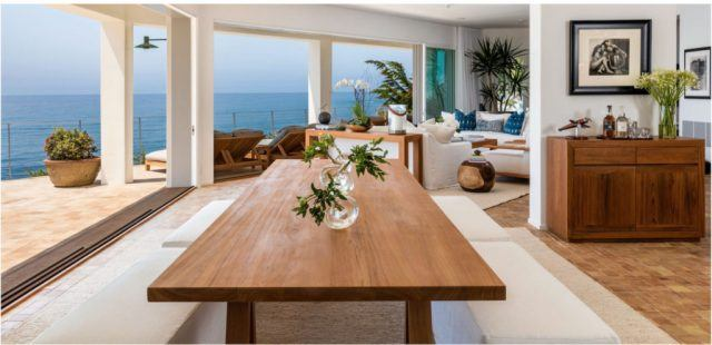 An interior view of Cindy Crawford's malibu home features a wraparound porch and ocean views.
