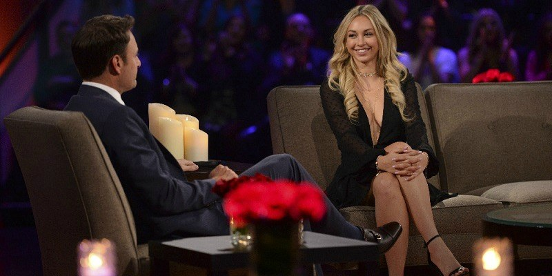 Corinne smiling at Chris Harrison on Women Tell All
