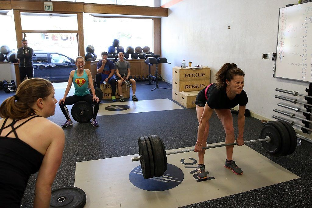 woman lifting at a gym