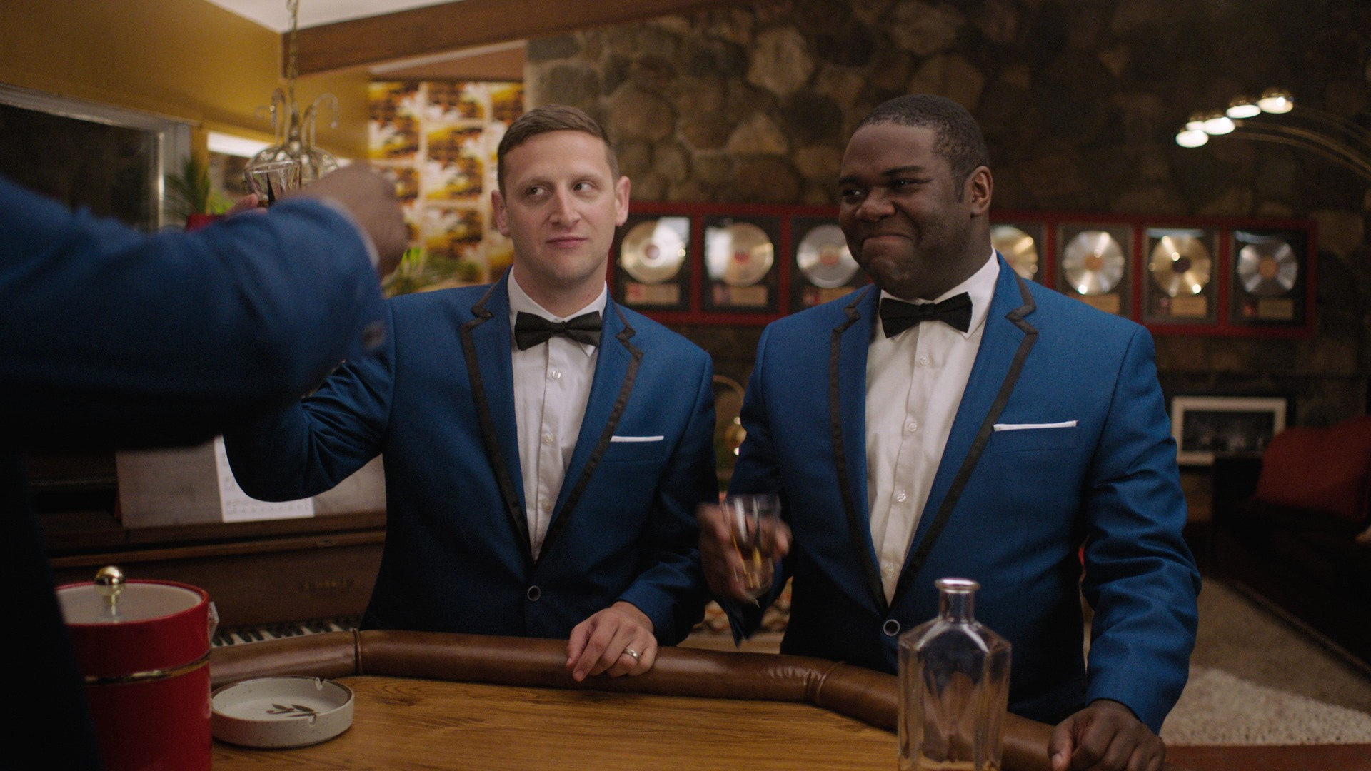 Sam Richardson and Tim Robinson raise a toast in a scene from Detroiters