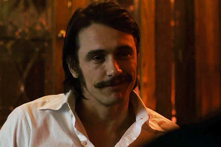 James Franco dons a mustache and long hair in The Deuce