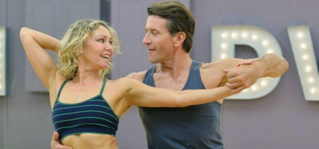 Robert and Kym Herjavec dancing together and looking at each other.