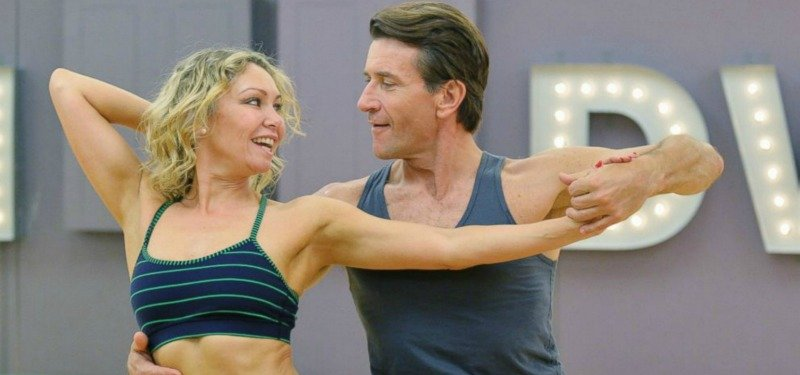 Robert and Kym Herjavec dancing together and looking at each other