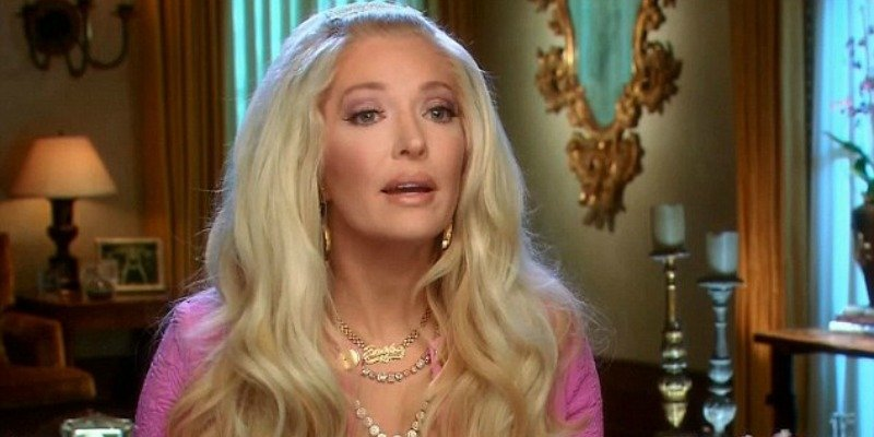 Erika Jayne sporting big hair and talking to the camera