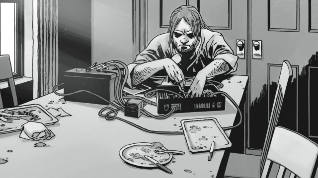 Eugene working on a battery in a panel from 'The Walking Dead' comics.