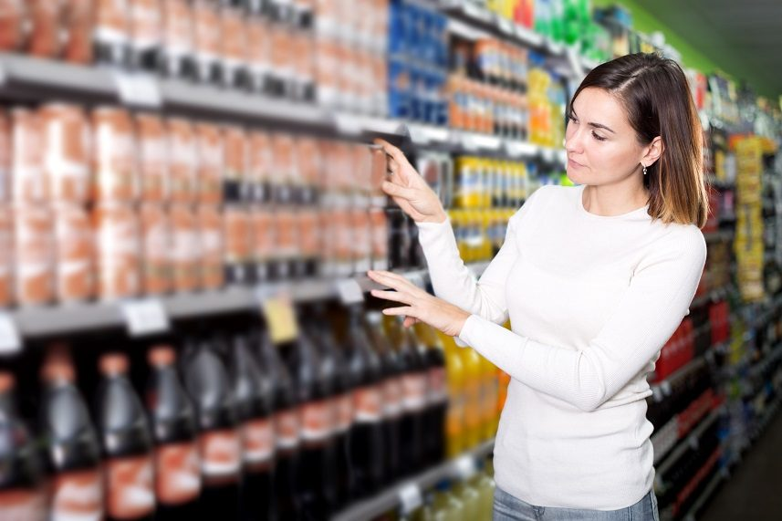 female shopper searching for beverages