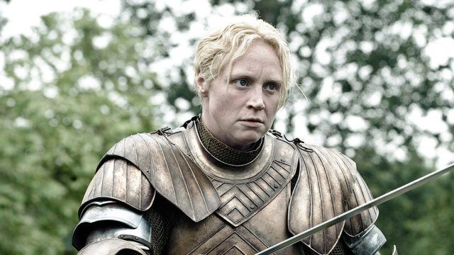 Brienne of Tarth, in her armor, brandishes her sword in a scene from 'Game of Thrones.'