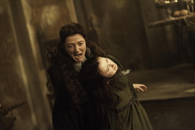 Catelyn Stark screams as she holds a knife to the throat of Walder Frey's wife in a scene from 'The Rains of Castamere.'