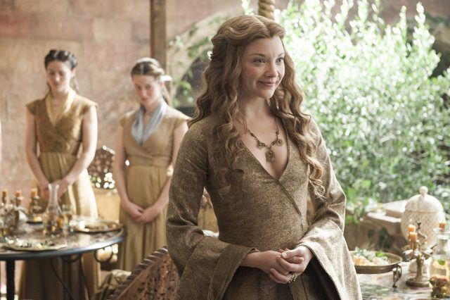 Maegary Tyrell smiles brightly in a scene from 'Game of Thrones.'