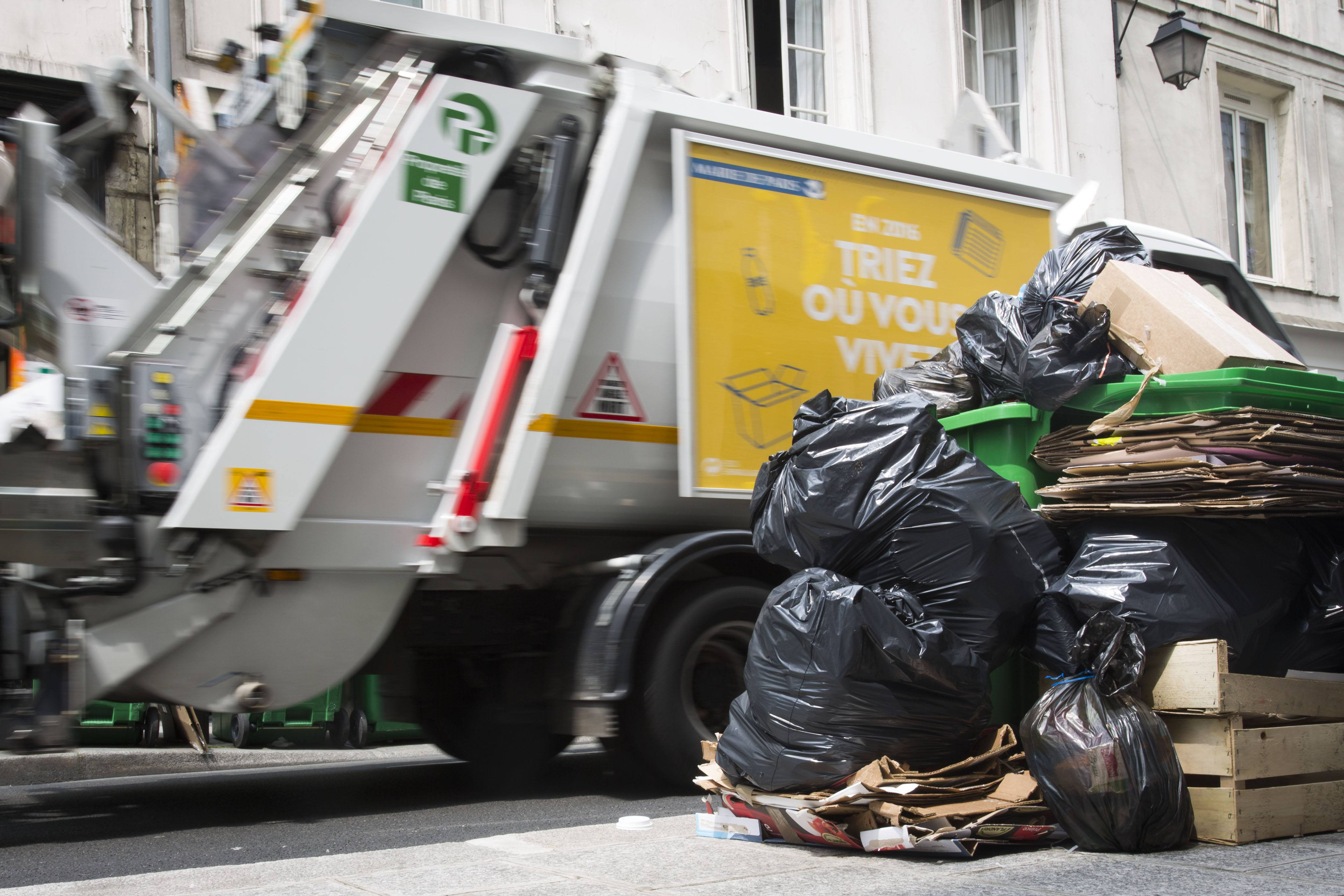 A French garbage truck collects refuse