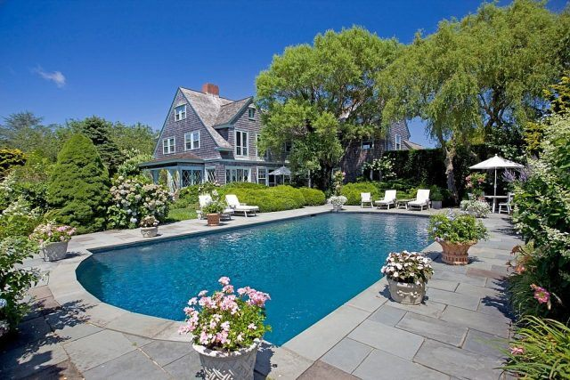 The 'Grey Gardens' estate, currently owned by journalist Sally Quinn, has a pool and lush gardens.