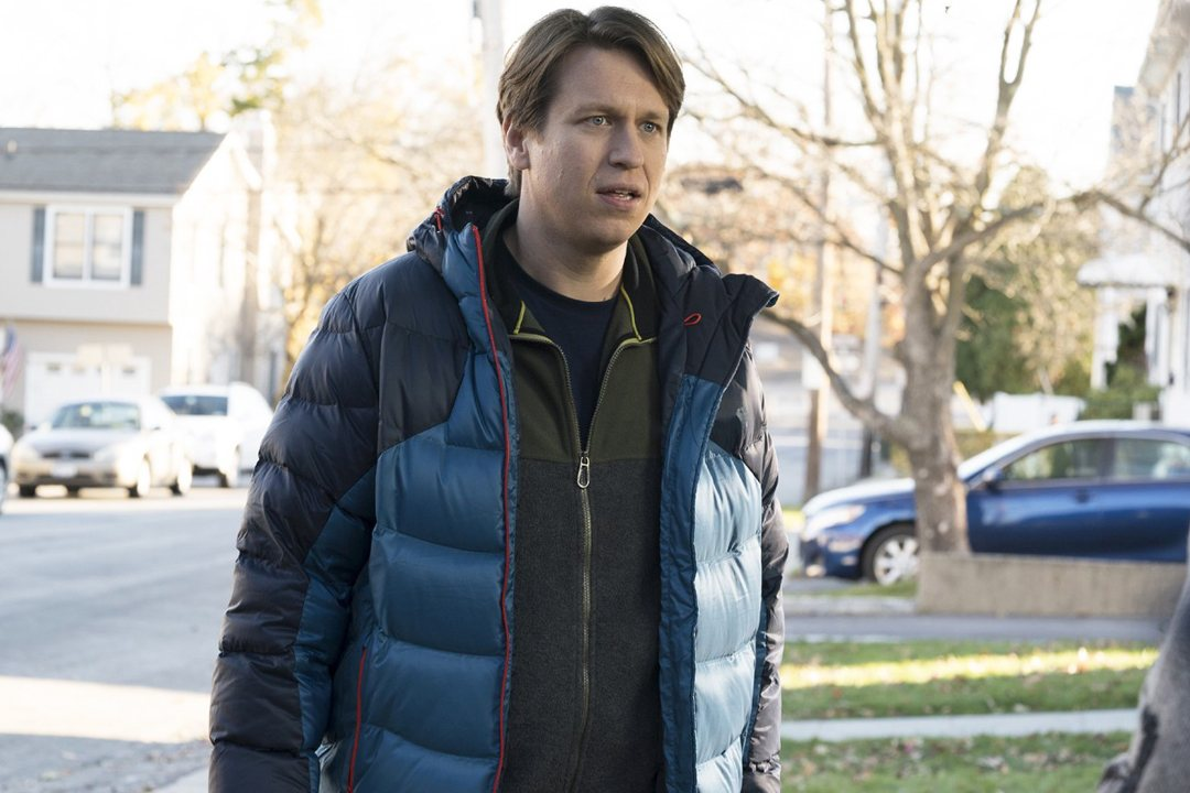 Peter Holmes stands outside in a scene from HBO's Crashing