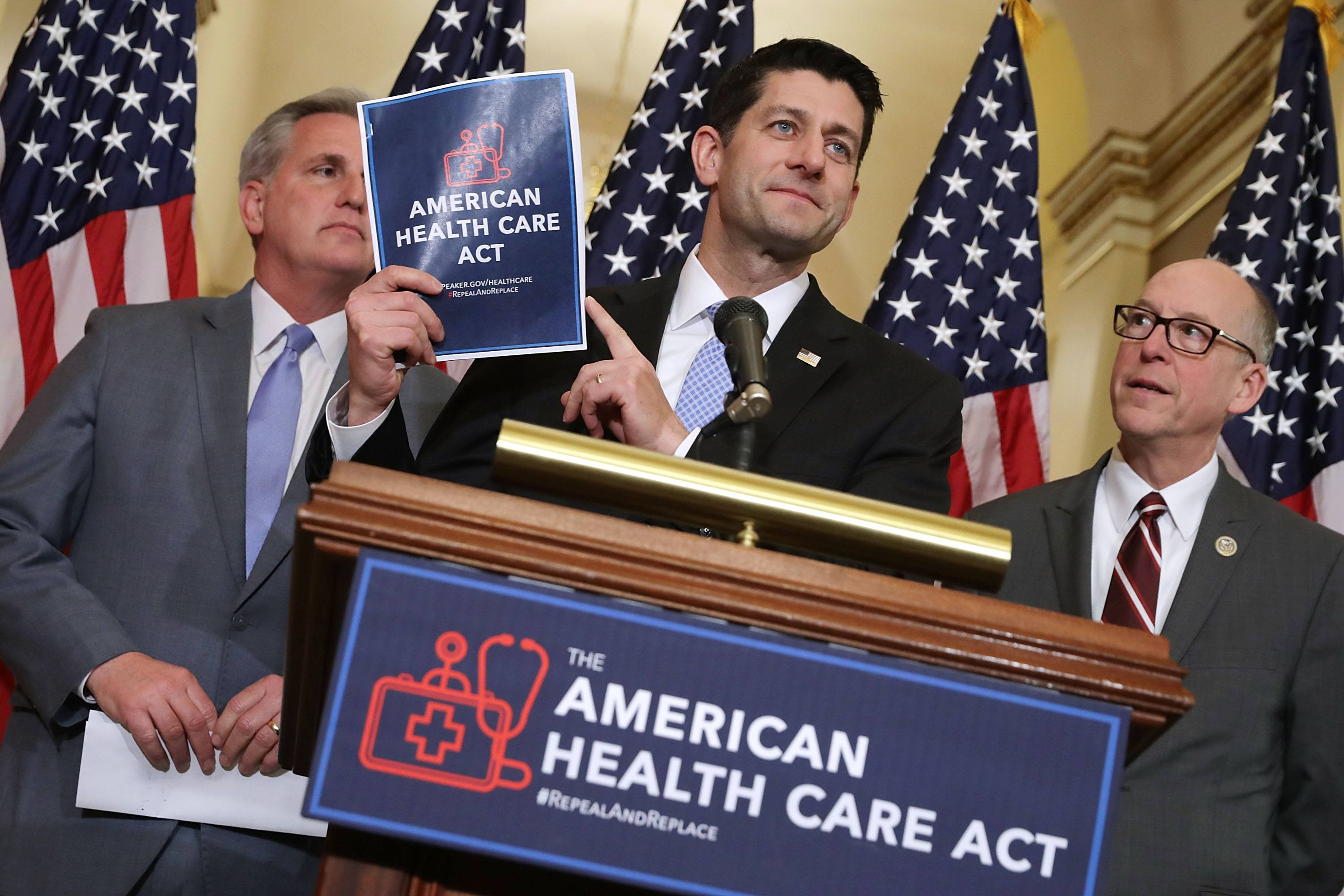 Paul Ryan holds up a copy of the American Health Care Act