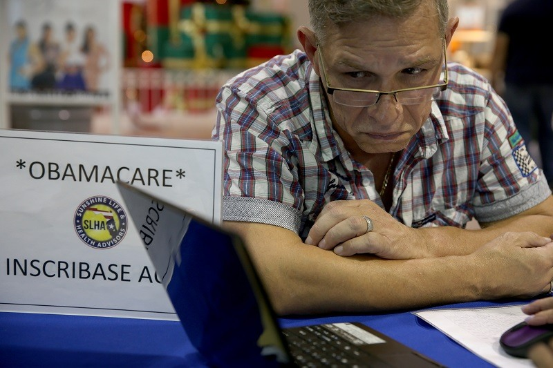 A man looks at his health care options