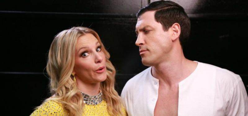 Heather Morris makes a funny face at the camera as Maks Chmerkovskiy looks at her.