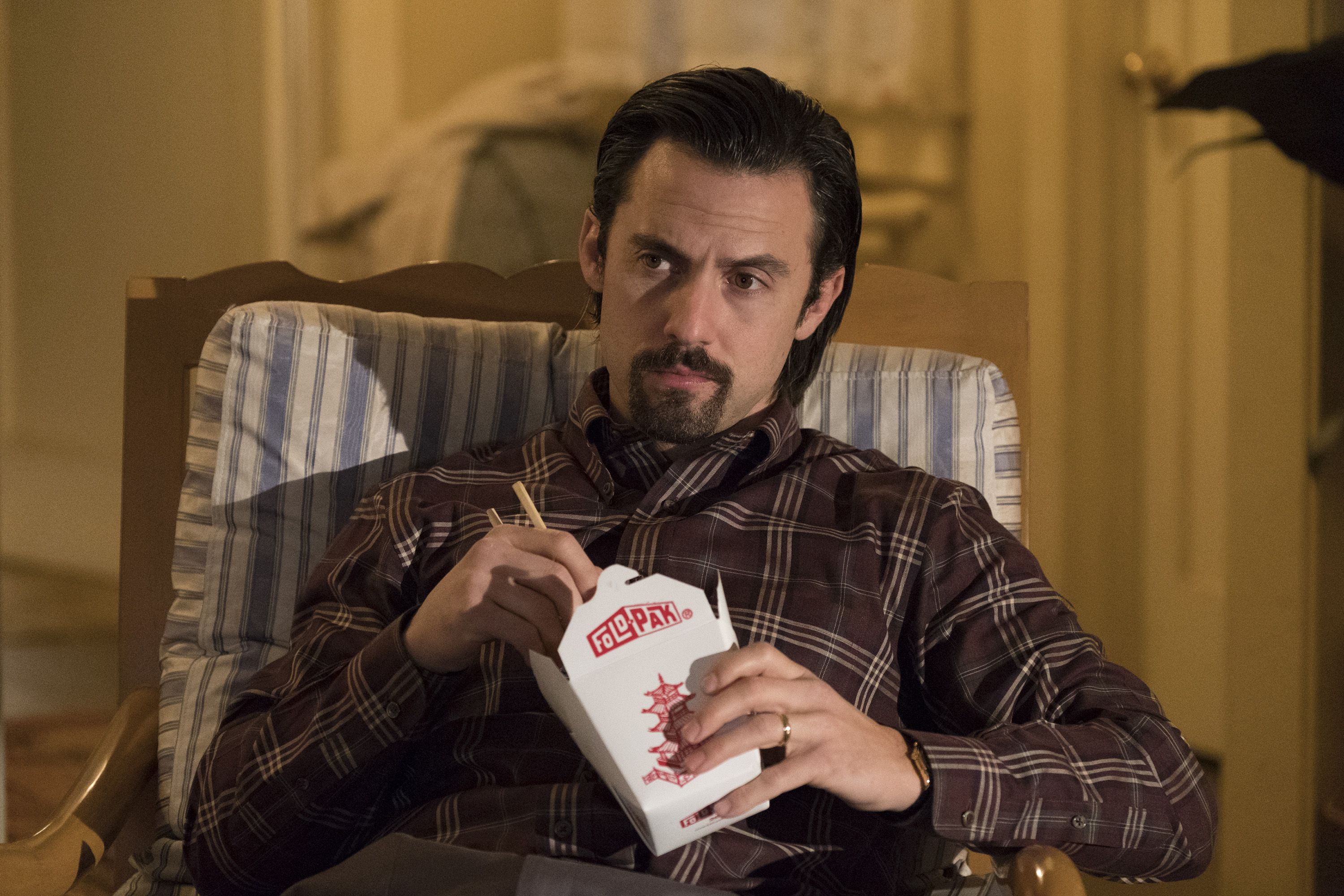 Milo Ventimiglia's Jack Pearson eats Chinese food in a scene from NBC's This is Us