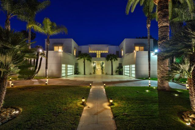 Jackie Collins' modern estate in the Hollywood Hills is surrounded by palm trees.