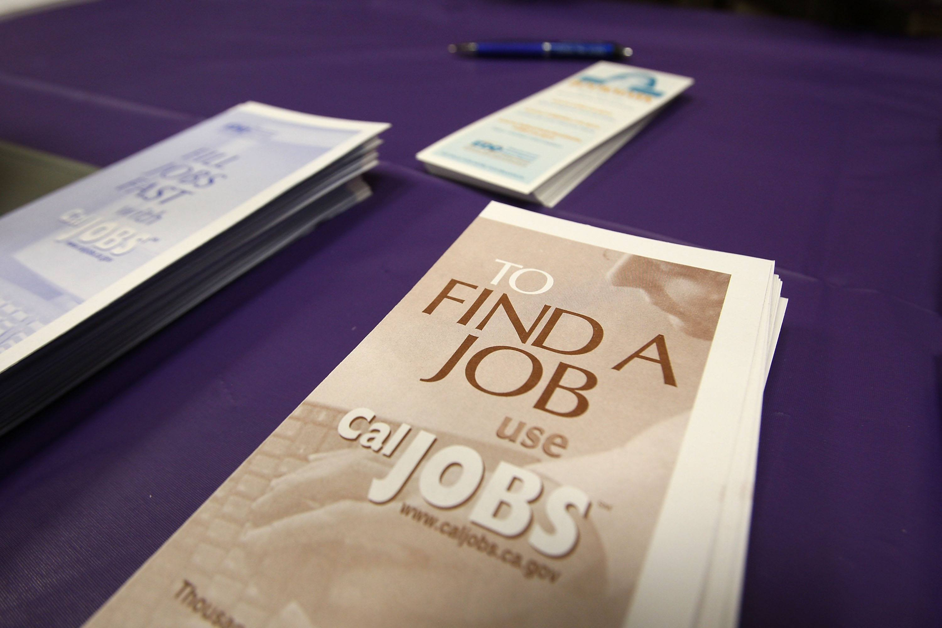 Pamphlets sit on a table during a California job fair