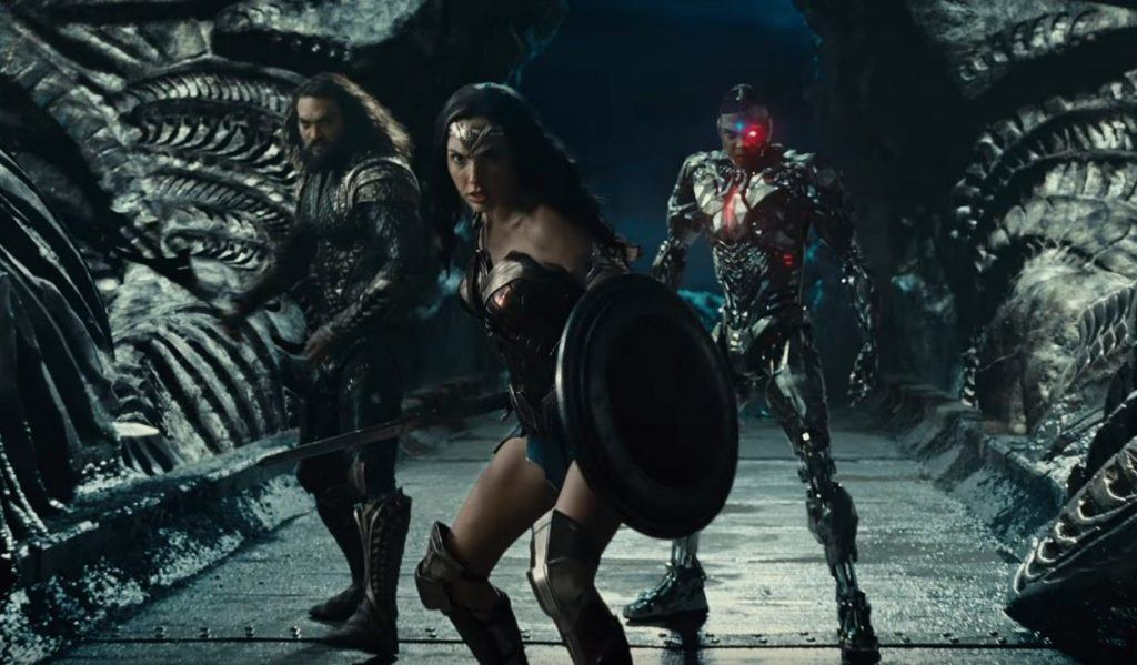 Wonder Woman leads Aquaman and Cyborg in battle in a scene from Justice League
