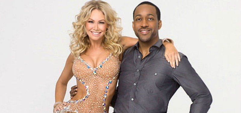 Kym Johnson and Jaleel White are posing together with their arms around each other.