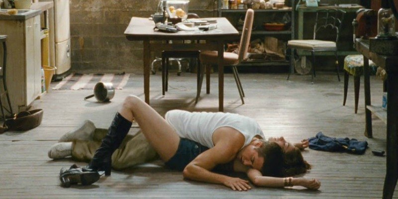 Jamie lying on top of Maggie on the floor in Love & Other Drugs