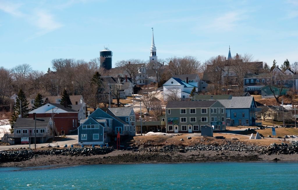Church spires and a water tank stand atop a hill in Lubec, Maine