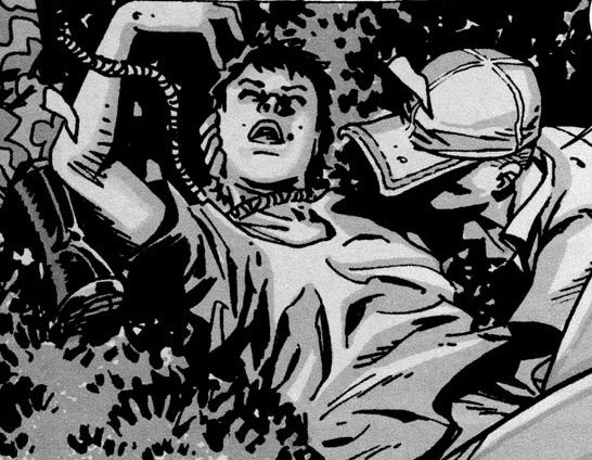 Glenn rescues Maggie, with a rope around her neck, in a panel from 'The Walking Dead' comics.