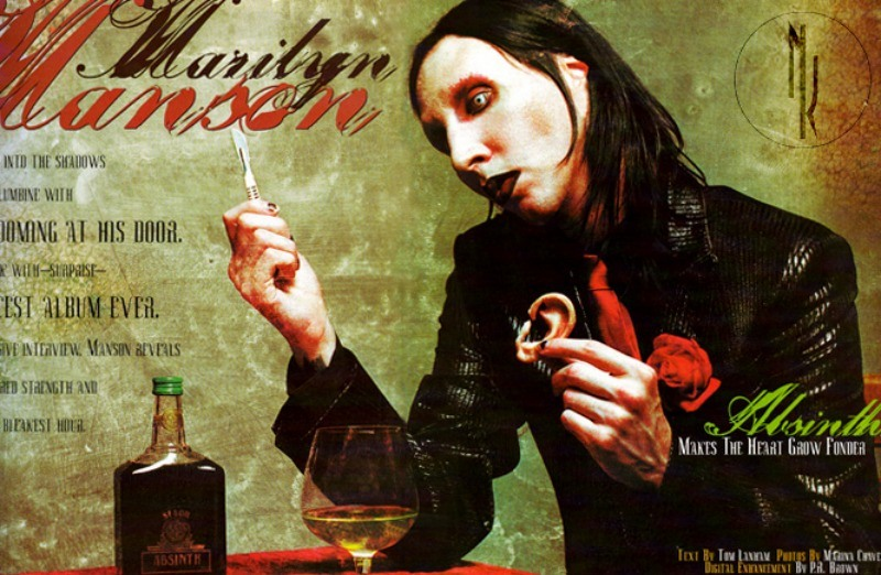 Marilyn Manson holding a cut off ear next to a glass and bottle of Mansinthe