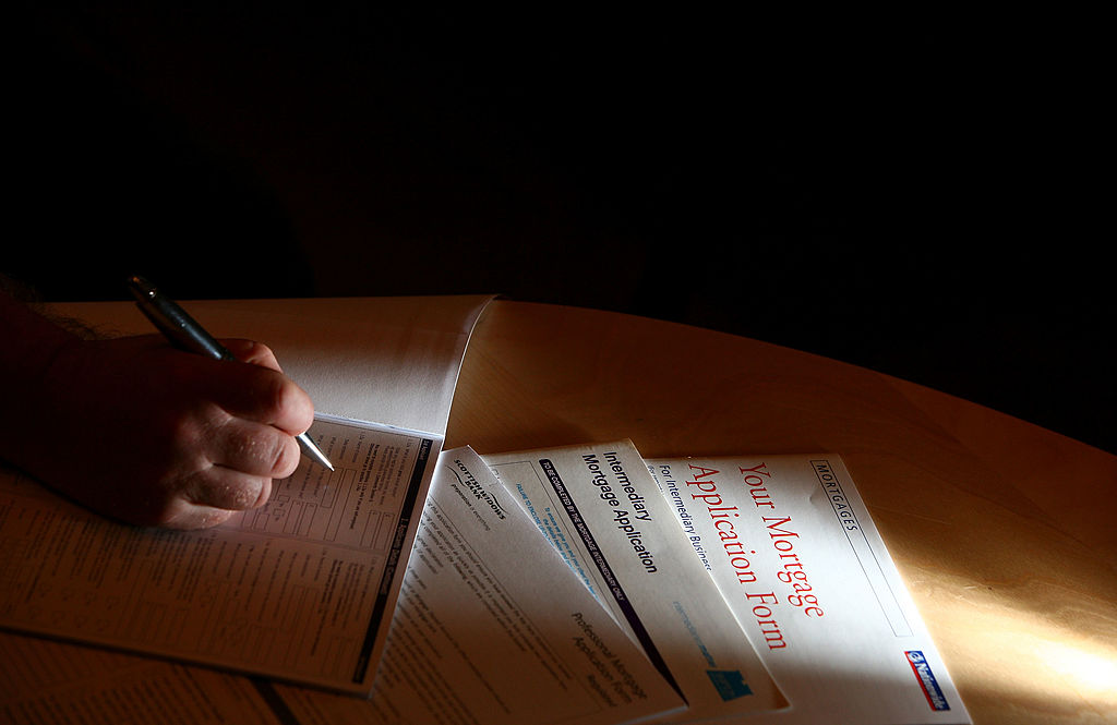 A man looks over financial forms