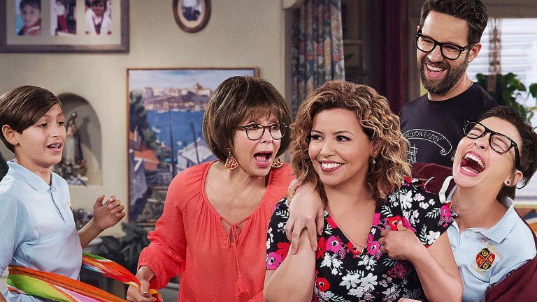 The cast of One Day at a Time break into laughter