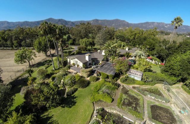 An aerial view of Oprah's Montecito, California estate shows a sprawling mansion and large property.