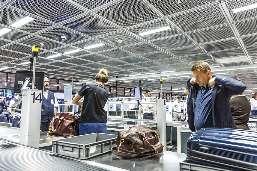 people at security check at Frankfurt international airport