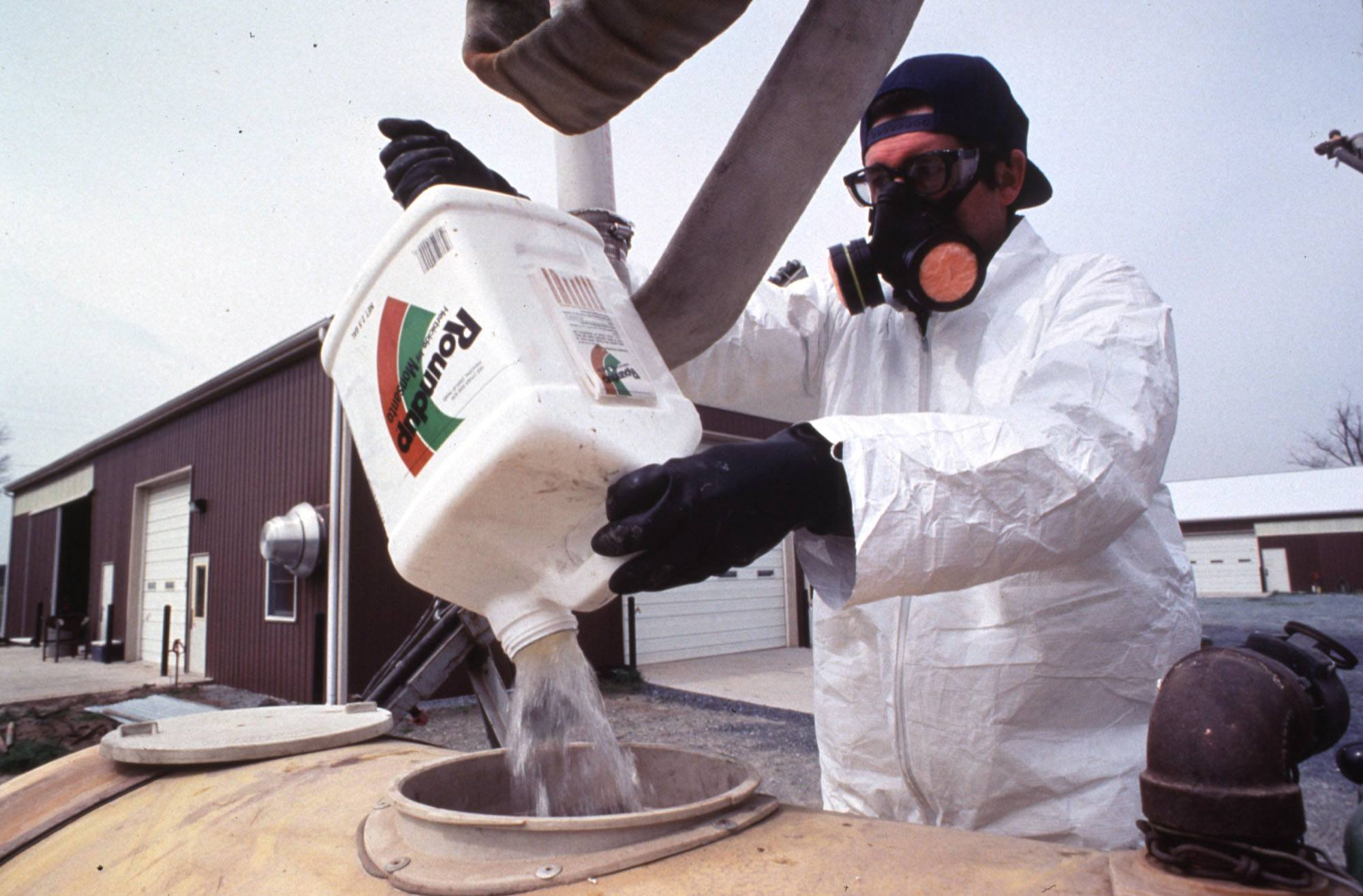 A farm worker handles a common pesticide