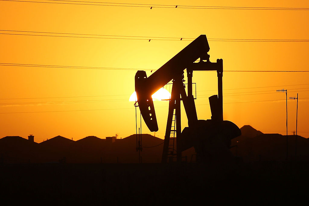 A pumpjack sits on the outskirts of town at dawn in the Permian Basin oil field