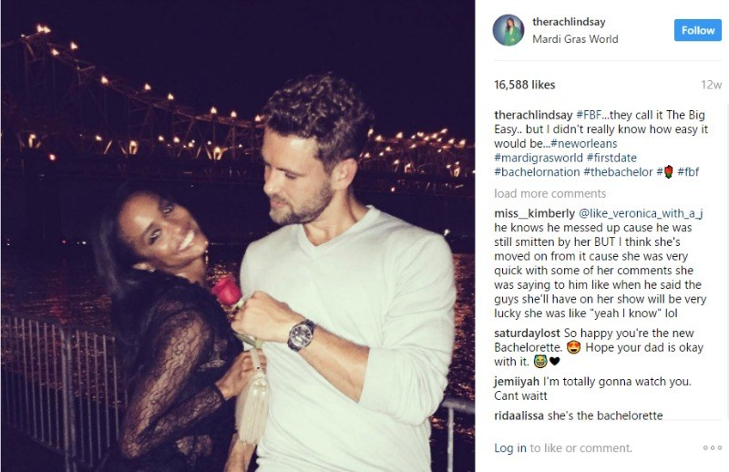 Rachel Lindsay and Nick Viall pose together and he hands her a rose.