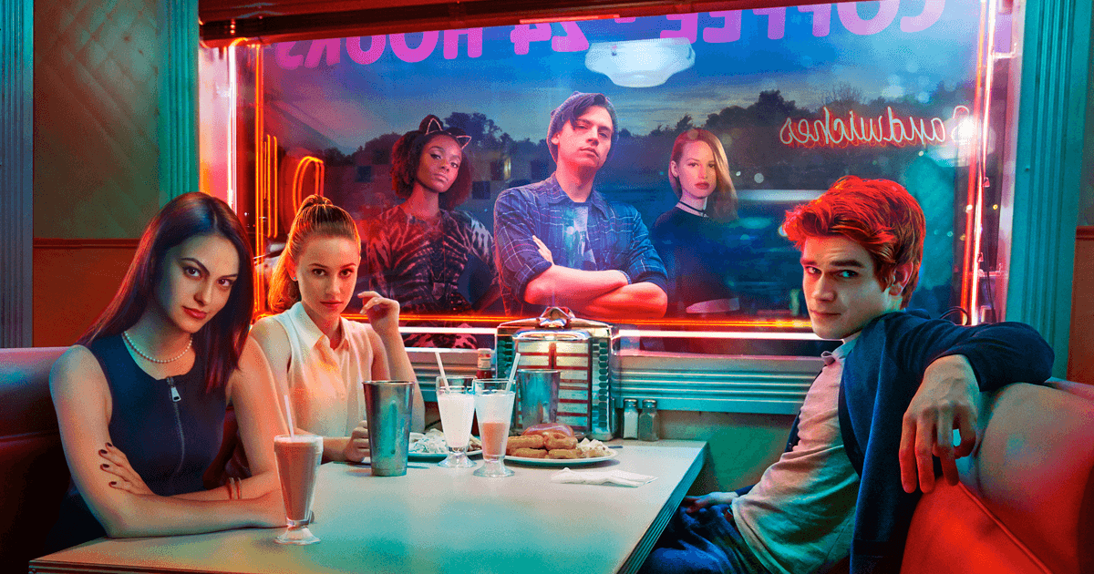 The cast of The CW's Riverdale pose in a booth