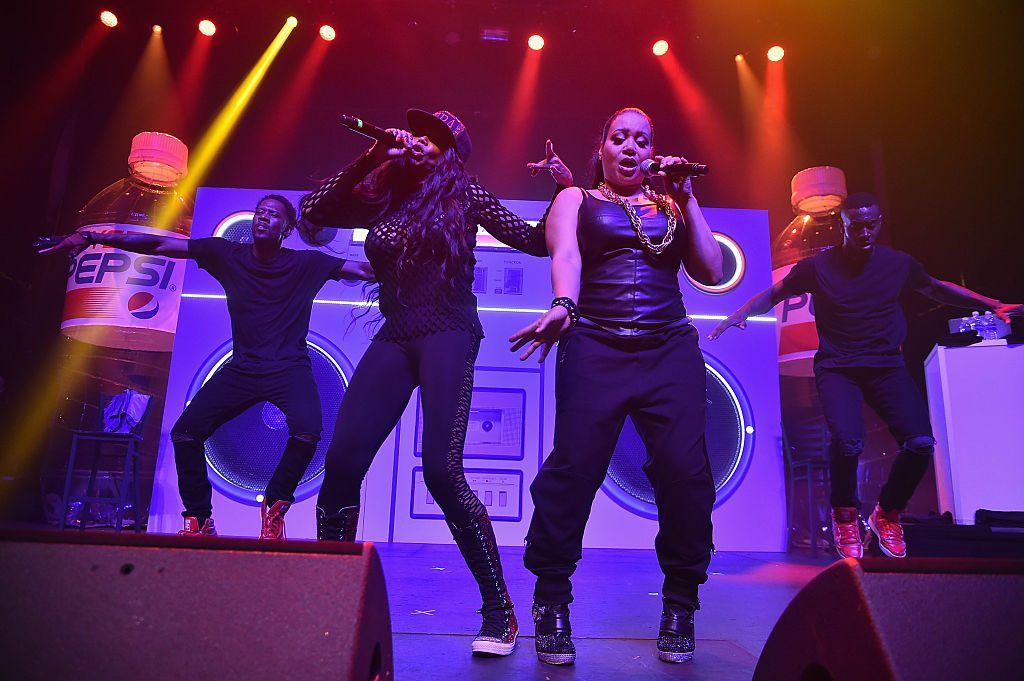 Salt-N-Pepa on stage dancing and singing