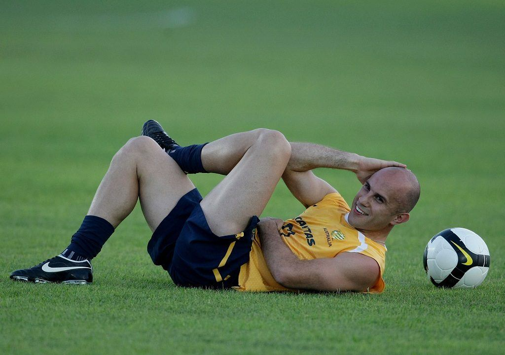 Soccer player Marco Bresciano of Australia doing crunches