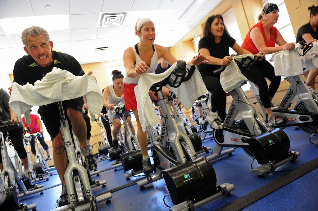 People enjoying spin class