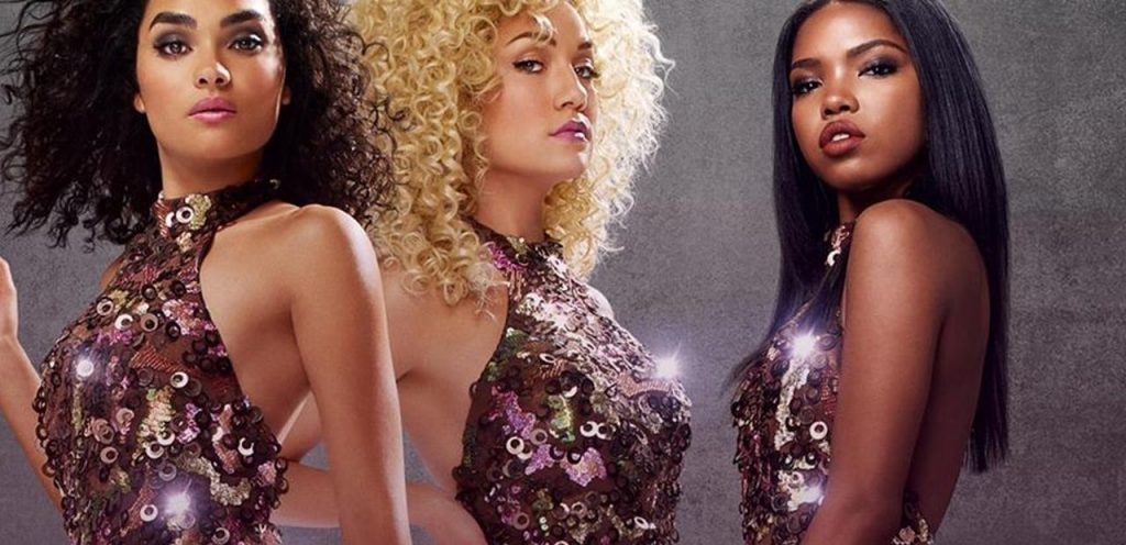 Three women in sparkly dresses look at the camera in a promo photo for FOX's Star
