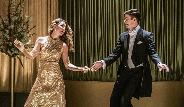 A woman and a man dancing in fancy attire.
