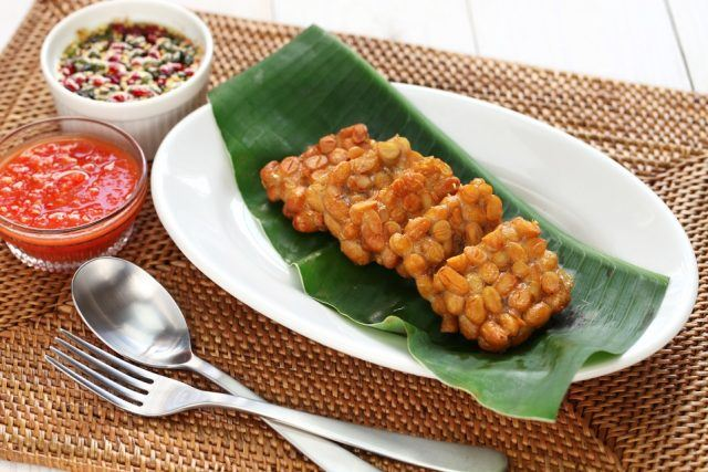 Fried squares of tempeh laid out on a long plate.