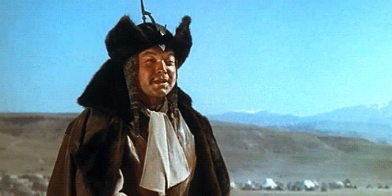 Orson Welles as Genghis Khan on a horse in The Black Rose.