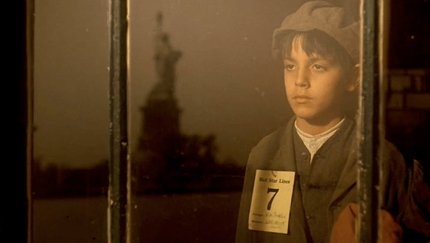 Young Vito is looking at the Statue of Liberty.