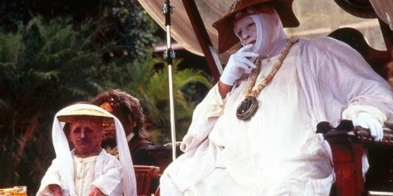Marlon Brando sits down as Dr. Moreau in The Island of Dr. Moreau